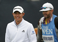 14th July 2021; The Royal St. George's Golf Club, Sandwich, Kent, England; The 149th Open Golf Championship, practice day; Collin Morikawa (USA) smiles as he walks from the tee at the 1st hole