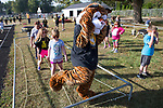 """September 15, 2017- Tuscola, IL- Northward 2nd graders follow their mascot """"Tiger"""" through the rope course during the 1st annual Tiger Trot. [Photo: Douglas Cottle]"""