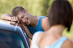Young couple by car
