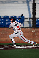 Danville Braves second baseman Greg Cullen (9) follows through on a swing during a game against the Johnson City Cardinals on July 29, 2018 at TVA Credit Union Ballpark in Johnson City, Tennessee.  Johnson City defeated Danville 8-1.  (Mike Janes/Four Seam Images)
