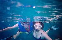 Snorkling couple underwater<br />