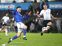 20th March 2021; Liberty Stadium, Swansea, Glamorgan, Wales; English Football League Championship Football, Swansea City versus Cardiff City; Kieffer Moore of Cardiff City and Ryan Bennett of Swansea City challenge for the ball