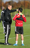 Pictured L-R: Garry Monk and Leon Britton Wednesday 05 November 2014<br /> Re: Swansea City FC players training at Fairwood training ground, ahead of their Premier League game against Arsenal on Sunday.