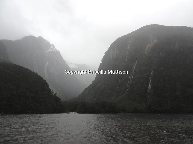 Fiordland National Park, New Zealand - September 14, 2012:  Light breaks through the mist in Doubtful Sound.