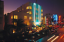 Aerial view of the Beacon Hotel located on Ocean Drive in the Miami Beach Art Deco district. View taken at night with neon lights glowing.