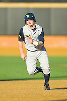 Taylor Munden (3) of the West Virginia Mountaineers takes takes off for third base against the Wake Forest Demon Deacons at Wake Forest Baseball Park on February 24, 2013 in Winston-Salem, North Carolina.  The Demon Deacons defeated the Mountaineers 11-3.  (Brian Westerholt/Four Seam Images)