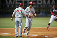 Chattanooga Lookouts coach Darren Bragg shakes hands with Jose Siri (2) rounding third after a Ibandel Isabel (not shown) home run during a Southern League game against the Birmingham Barons on July 24, 2019 at Regions Field in Birmingham, Alabama.  Chattanooga defeated Birmingham 9-1.  (Mike Janes/Four Seam Images)