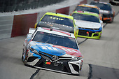 DARLINGTON, SOUTH CAROLINA - MAY 17: Kyle Busch, driver of the #18 M&M's Toyota, leads a pack of cars during the NASCAR Cup Series The Real Heroes 400 at Darlington Raceway on May 17, 2020 in Darlington, South Carolina. NASCAR resumes the season after the nationwide lockdown due to the ongoing coronavirus (COVID-19).  (Photo by Jared C. Tilton/Getty Images)