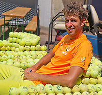 Austria, Kitzbuhel, Juli 15, 2015, Tennis, Davis Cup, Training Dutch team, after pracitse Robin Haase is relaxing in a ballchair<br /> Photo: Tennisimages/Henk Koster