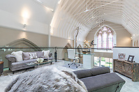 BNPS.co.uk (01202) 558833. <br /> Pic: LuxuryAndPrestige/BNPS<br /> <br /> Pictured: First floor sitting area. <br /> <br /> A heavenly converted chapel that has been transformed into a contemporary home is on the market for £1.5m.<br /> <br /> The Old Chapel was used by an order of nuns for 139 years before the humble church got a stylish upgrade into a four-bedroom property.<br /> <br /> The Grade II listed building has been carefully restored to retain stunning ecclesiastical features like windows, archways and doors, but with a modern twist.<br /> <br /> And although the owner bought it from the developer before it was finished, the stunning home has never been lived in.