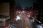 April 12, 2020<br /> New York, New York<br /> <br /> Looking East down an empty East Broadway in lower Manhattan after dark at the height of the coronavirus pandemic. More than 10,000 deaths reported throughout the state.