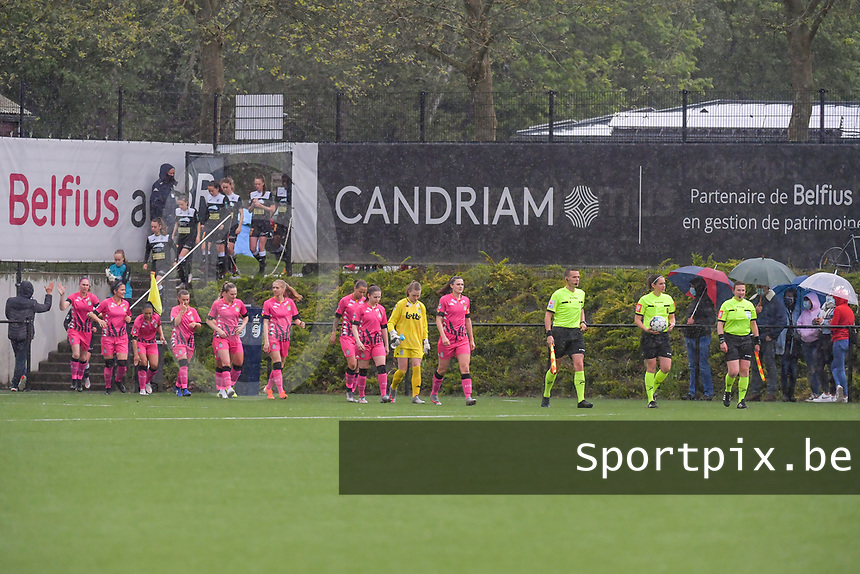 the players enter the field pictured before a female soccer game between Sporting Charleroi and Eendracht Aalst on the 8th matchday in play off 2 of the 2020 - 2021 season of Belgian Scooore Womens Super League , tuesday 18 th of May 2021 in Marcinelle , Belgium . PHOTO SPORTPIX.BE | SPP | STIJN AUDOOREN