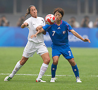 Japanese defender (7) Kozue Ando tries to keep the ball away from New Zealand defender (17) Marlies Oostdam during first round play in the 2008 Beijing Olympics at Qinhuangdao, China. .  Japan tied New Zealand, 2-2, at Qinhuangdao Stadium.