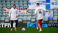 Blackpool's Jerry Yates, right, wearing a t-shirt in tribute to Warren Green, Blackpool's academy manager, who died aged 46<br /> <br /> Photographer Chris Vaughan/CameraSport<br /> <br /> The EFL Sky Bet League One - Peterborough United v Blackpool - Saturday 21st November 2020 - London Road Stadium - Peterborough<br /> <br /> World Copyright © 2020 CameraSport. All rights reserved. 43 Linden Ave. Countesthorpe. Leicester. England. LE8 5PG - Tel: +44 (0) 116 277 4147 - admin@camerasport.com - www.camerasport.com