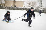 Justin Mc Grath and Thomas Mc Guire having fun in the snow at Woodstock View in Ennis. Photograph by John Kelly.