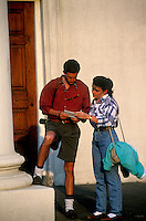 Young couple pausing to look at a map while sightseeing.
