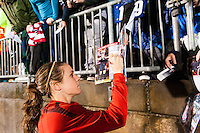 Heather O'Reilly (9) of the United States (USA) signs autographs after the match. The United States (USA) and Germany (GER) played to a 2-2 tie during an international friendly at Rentschler Field in East Hartford, CT, on October 23, 2012.
