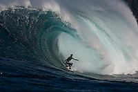 A surfer in action on a big wave.