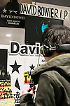A man listens the discography of David Bowie on sale at Tower Records in Shibuya on January 12, 2016, Tokyo, Japan. Tower Records created a special section for the British singer, songwriter and actor David Bowie, who died of cancer at the age of 69 on January 10, 2016. His recently released album Blackstar is now sold out in Japan. (Photo by Rodrigo Reyes Marin/AFLO)