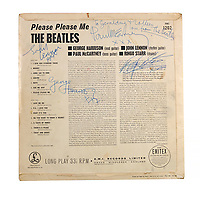 """BNPS.co.uk (01202) 558833. <br /> Pic: Bonhams/BNPS<br /> <br /> A rare album sleeve the Beatles signed for a police officer who protected them has sold for £24,000.<br /> <br /> The Fab Four autographed the Please Please Me sleeve for the Metropolitan Police Officer backstage at a show at the Astoria in Finsbury Park in circa 1963.<br /> <br /> Paul McCartney added the dedication: """"To Geraldine and Colleen, love from The Beatles."""""""