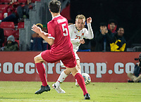 COLLEGE PARK, MD - NOVEMBER 15: Matt Di Rosa #27 of Maryland shoots past Daniel Munie #5 of Indiana during a game between Indiana University and University of Maryland at Ludwig Field on November 15, 2019 in College Park, Maryland.