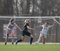 LOUISVILLE, KY - MARCH 13: Freja Olofsson #8 of Racing Louisville FC and Alina Stahl #24 of West Virginia University fight for ball during a game between West Virginia University and Racing Louisville FC at Thurman Hutchins Park on March 13, 2021 in Louisville, Kentucky.