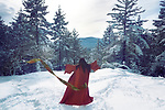 Artistic photo of the back of an asian woman in red kimono dancing, spinning around on the snow in winter forest tossing her obi belt away Image © MaximImages, License at https://www.maximimages.com