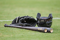 Baseball bat, helmet and glove on June 22, 2014 at the Dell Diamond in Round Rock, Texas. (Andrew Woolley/Four Seam Images)