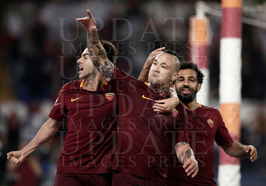 Calcio, Serie A: Roma vs Juventus. Roma, stadio Olimpico, 14 maggio 2017. <br /> Roma's Radja Nainggolan, center, celebrates with teammates Stephan El Shaarawy, left, and Mohamed Salah after scoring during the Italian Serie A football match between Roma and Juventus at Rome's Olympic stadium, 14 May 2017. Roma won 3-1.<br /> UPDATE IMAGES PRESS/Isabella Bonotto