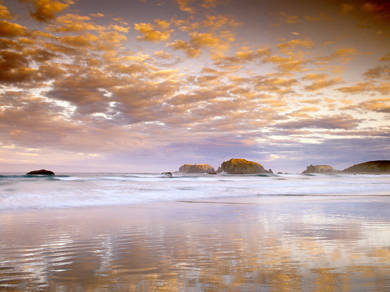 Low tide, sunrise and reflection at Bandon Beach, Oregon