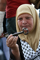 """Gaza.15.05.2008.Palestinian woman carry key during a rally marking the 'Nakba' (Catastrophe) in the West Bank city of Ramallah. Palestinians protested across the occupied territories on the 60th anniversary of the 'catastrophe' of the birth of Israel today as the Jewish state's army went on high alert. The commemoration of the Naqba, or 'catastrophe' -- the defeat of five invading Arab armies and the expulsion or flight of about 760,000 people -- comes as US President George W. Bush addresses Israel's parliament.""""phto Iyad Jadalah"""""""