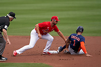 St. Louis Cardinals shortstop Paul DeJong (11) tags Carlos Correa (1) sliding into second base during a Major League Spring Training game against the Houston Astros on March 20, 2021 at Roger Dean Stadium in Jupiter, Florida.  (Mike Janes/Four Seam Images)