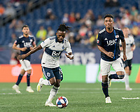 FOXBOROUGH, MA - JULY 18: Lass Bangoura #19 brings the ball forward during a game between Vancouver Whitecaps and New England Revolution at Gillette Stadium on July 18, 2019 in Foxborough, Massachusetts.