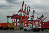 ELIZABETH, NEW JERSEY - APRIL 29 : Trucks and cranes are seen on duty at the Elizabeth Port on April 29, 2021 in New Jersey. (Photo by Kena Betancur/VIEWpress)