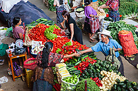 Chichicastenango, Guatemala.  Buying and Selling Fresh Vegetables in the Indoor Market.