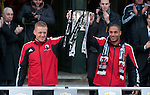 Swansea City Football team Captains Gary Monk and Ashley Williams holding the Capital Cup trophy centre outside the Brangwyn Hall inSwansea after beating Bradford City 5-0 in Sunday's Capital One Cup final at Wembley to win the Capital Cup trophy.