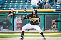 Kyle Kubitza (10) of the Salt Lake Bees lays down the bunt against the Sacramento River Cats in Pacific Coast League action at Smith's Ballpark on April 20, 2015 in Salt Lake City, Utah.  (Stephen Smith/Four Seam Images)