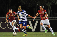 20130906 - OOSTAKKER , BELGIUM : Gent's Margaux Van Ackere pictured surrounded by PSV Manon Van Den Boogaard (right) and PSV Danielle Van De Donk (left) during the female soccer match between AA Gent Ladies  and PSV / FC Eindhoven Dames , of the third matchday in the BENELEAGUE competition. Friday 06 th September 2013. PHOTO DAVID CATRY