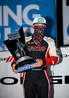 Nov 1, 2020; Las Vegas, Nevada, USA; NHRA top fuel driver Steve Torrence celebrates with the 2020 top fuel world championship trophy after the NHRA Finals at The Strip at Las Vegas Motor Speedway. Mandatory Credit: Mark J. Rebilas-USA TODAY Sports