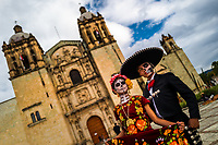 A young Mexican woman, dressed as La Catrina, accompanied by a young Mexican man, dressed as Mariachi, pose for a picture during the Day of the Dead festivities in Oaxaca, Mexico, 31 October 2019. Day of the Dead (Día de Muertos), a religious holiday combining the death veneration rituals of Pre-Hispanic cultures with the Catholic practice, is widely celebrated throughout all of Mexico. Based on the belief that the souls of the departed may come back to this world on that day, people gather together while either praying or joyfully eating, drinking, and playing music, to remember friends or family members who have died and to support their souls on the spiritual journey.