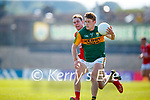 Gavin White, Kerry, in action against Cian Kiely, Cork, during the Munster GAA Football Senior Championship Final match between Kerry and Cork at Fitzgerald Stadium in Killarney on Sunday.