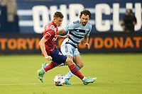 KANSAS CITY, KS - JULY 31: Szabolcs Schon #11 FC Dallas watched by Graham Zusi #8 Sporting KC during a game between FC Dallas and Sporting Kansas City at Children's Mercy Park on July 31, 2021 in Kansas City, Kansas.