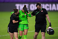 ORLANDO CITY, FL - FEBRUARY 18: Kailen Sheridan #18 is assisted off the field with an injury by Canada Staff during a game between Canada and USWNT at Exploria stadium on February 18, 2021 in Orlando City, Florida.