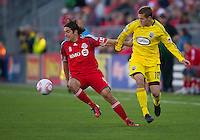 October 16 2010  Toronto FC defender Nick Garcia #4 and Columbus Crew midfielder Robbie Rogers #18 in action during a game between the Columbus Crew and Toronto FC at BMO Field in Toronto..The final score was a 2-2 draw.