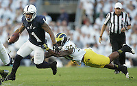 State College, PA - 10/12/2013:  RB Bill Belton attempts to avoid the tackle of Michigan safety Thomas Gordon during the first half.  Belton carried the ball 27 times for 90 yard and one touchdown.  Penn State defeated Michigan by a score of 43-40 in 4 overtimes on Saturday, October 12, 2013, at Beaver Stadium.<br /> <br /> Photos by Joe Rokita / JoeRokita.com