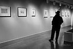 Dayton Art Institute (art museum) patron viewing artwork. Black and white