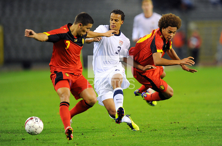 USA's Timmy Chandler (M) and Belgium's Axel Witsel (r) and Eden Hazard (l) fight for the ball during the friendly match Belgium vs USA at King Baudoin stadium in Brussels, Belgium on September 06th, 2011.