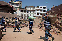 Nepali police man carries rescue equipment during a search operation at Kathmandu Durbar Square, Kathmandu, Nepal. May 03, 2015