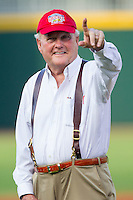 """Howard """"Humpy"""" Wheeler salutes the fans at BB&T Ballpark prior to throwing out a ceremonial first pitch prior to the game between the Gwinnett Braves and the Charlotte Knights on August 19, 2014 in Charlotte, North Carolina.  Wheeler is the former President and General Manager of Charlotte Motor Speedway.   (Brian Westerholt/Four Seam Images)"""