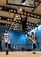 Lacey James of Surrey Scorchers raises high to the basket to dunk during the BBL Championship match between Surrey Scorchers and Newcastle Eagles at Surrey Sports Park, Guildford, England on 20 March 2021. Photo by Liam McAvoy.